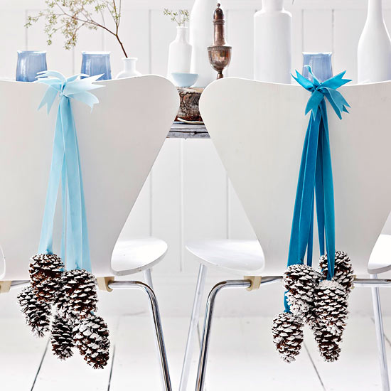 Christmas-decorating-ideas-for-small-spaces-dining-chairs-cones-and-ribbons