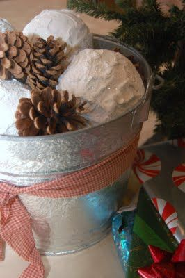 Snowballs & pinecones in a bucket...too cute!