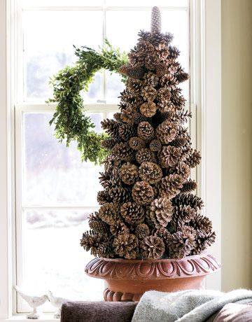 Easy to make pinecone tree. One planter, one styrofoam cone, some pinecones, wire, and glue. This would be easy and smell amazing. You could also glue some fake red berries on it too!