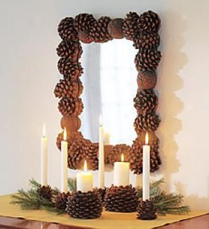 Great, easy Christmas decor. Exchange the evergreen boughs for leaves and vines and the pine cone candle holders for pumpkin candle holders to get a great Autumn display.