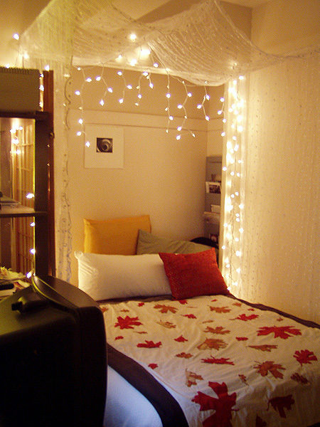 Make a lit-up bed canopy using icicle lights.
