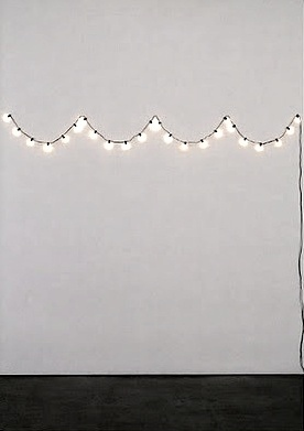 String lights in a scalloped pattern.