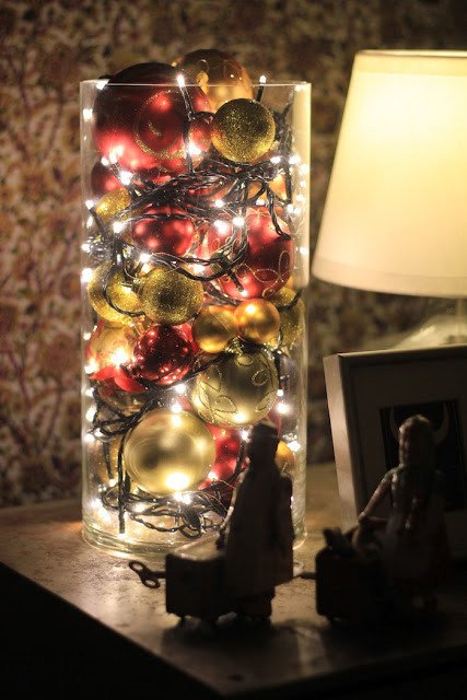 For the holidays, mix lights with old ornaments.