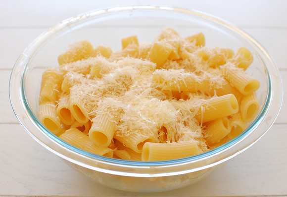 Toss the rigatoni with parmesan cheese.