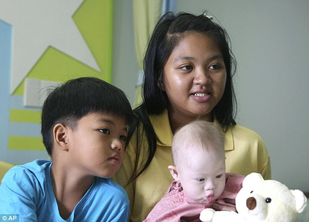 Gammy, pictured here with his older brother Game and mother Ms Chanbua, is expected to be moved to a hospital in Bangkok in the coming days