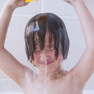 Girl washing her hair in bath