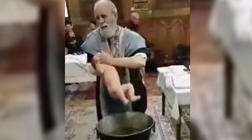 Βίντεο: Αδιανόητος παπάς κακοποιεί μωρό για να το βαφτίσει!