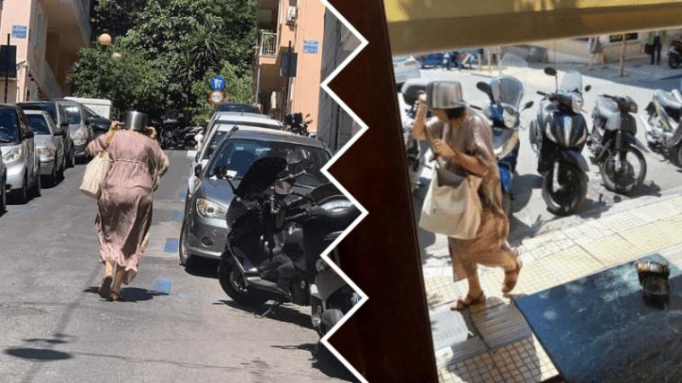 Α ρε κόσμε τρέλα-Κυρία ανεβαίνει την Βουκουρεστίου με χύτρα στο κεφάλι λόγω σεισμού