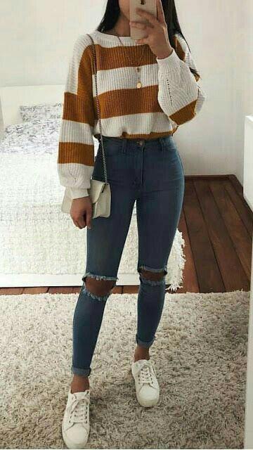 Τάσεις στα γυναικεία jean παντελόνια: σκούρο μπλε jean παντελόνι ψηλοκάβαλο