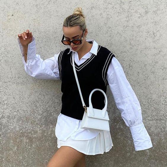 sweater_vest_με_μαύρο_μαλλινο γιλεκο_και_λευκό_πουκάμισο_